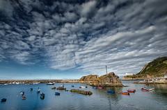 Shelter (Eduardo Regueiro) Tags: summer sky espaa clouds puerto spain day cloudy asturias cudillero d7000 eduardoregueiro