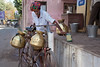 Milk Delivery Man  _6645 (hkoons) Tags: boy india man male men hat milk asia head masculine central gear vessel bowl pot pots copper motorcycle delivery turban dairy bowls brass rajasthan bundi hadoti