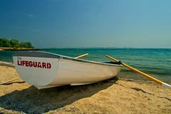 Boat (light_tracer) Tags: sea lake ontario canada beach boat lifeguard olympus panasonic 12mm polarizer f20 heliopan gx1 aperture3 summer2012 dmcgx1