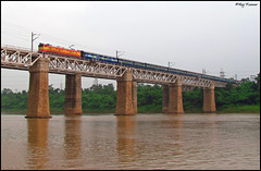 Swarna Rekha Express over Damodar...!! (Raj Kumar (The Rail Enthusiast)) Tags: bridge west water canon river coach indian tata pillar tracks locomotive railways bengal conventional raj girder jamshedpur kumar livery rekha dhanbad rajdhani swarna 21385 mughalsarai wam4 tatanagar asansol damodar sudamdih sx30is patherdih