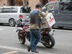 (kasa51) Tags: street city people japan digital lumix tokyo olympus panasonic motorbike motorcycle f18 45mm gf1 bikecourier mzuiko hondacb400superboldor