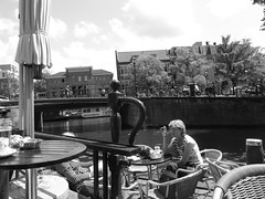 Cafs & Cigarettes (ellaratz) Tags: blackandwhite bw holland netherlands coffee caf dutch amsterdam canal europe glare cigarette smoking lonely