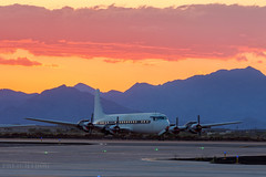 Boneyard Sunset (Freightdog Photography - Jared Romanowicz) Tags: sunset arizona phoenix graveyard plane airplane aviation az douglas boneyard prop goodyear dc7 gyr dc7c kgyr n777ea