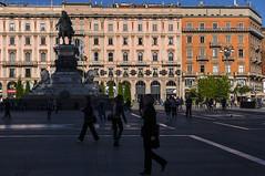 Milan 0513 (cbonney) Tags: morning italy milan silhouette statue architecture sunrise italian italia shadows milano piazza duomo commuters