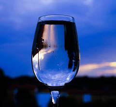 Glass of water in the window (annesjoberg) Tags: sunset sky reflection water glass square sony bluesky eveningsky glas solnedgång kvadrat glassofwater photosunday spegling sonyphoto fotosondag fotosöndag sonynex5t sonyphotograph fs160529