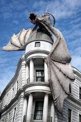 Gringotts Dragon (arteephact) Tags: architecture clouds orlando dragon florida harrypotter universalstudios themepark amount 2016 diagonalley gringottsbank sal1650 escapefromgringotts sonya77ii 1650mm28dt