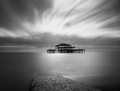 Ablaze (.willwalker) Tags: longexposure sea sky blackandwhite water clouds mono brighton le bnw ablaze brightonwestpier