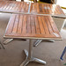 Teak stained wood outdoor table