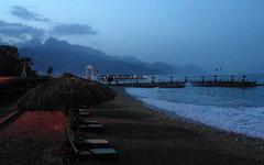 turkey beach evening light (kexi) Tags: beach evening sea water wave mediterranean turkey mountains unbrella pier samsung wb690 may 2015 blue landscape shore seaside coast instantfave