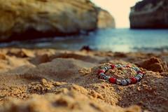 Somewhere far away. . . (wandering clouds) Tags: ocean travel sunlight macro beach nature sand outdoor australia jewellery bracelet greatoceanroad