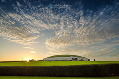 Midsummer sunset at Newgrange (mythicalireland) Tags: ireland sunset sky sun monument grass clouds landscape evening ancient midsummer dusk valley myth boyne newgrange meath passagetomb longestdays