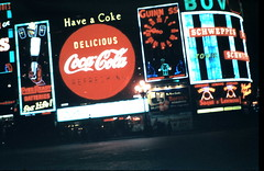 London, about March 1957 (allhails) Tags: london piccadillycircus guinness cocacola advertisements schweppes bovril monico everready guinnessclock cs03 monicosite