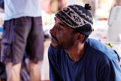 Le vendeur de coco allucin (Paolo Pizzimenti) Tags: 50mm ile olympus dxo f2 saintpaul march zuiko runion homme visage regard e5 filma pellicule vendeur hallucin