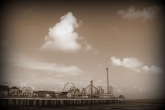The Pleasure Pier (the_dude771) Tags: ocean street new city trees light sky food moon house signs galveston brick water coffee caf grave car sign marie night train french dead mexico dessert louis pier corn orleans louisiana ship texas gulf cross shot cathedral market buried south tomb arc deep joan du quarter wreck monde bourbon chicory pleasure voodoo laveau beignets