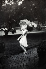On and on (Danielle Pearce) Tags: b 2 white black film girl rain umbrella canon vintage pretty mark w overlay betty ii spinning 5d raining