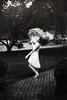 On and on (Danielle Pearce) Tags: b 2 white black film girl rain umbrella canon vintage pretty mark w overlay betty ii spinning 5d raining