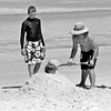 Burying the Baby (Mariasme) Tags: family blue sea summer beach hat fun bury sand postcard australia nsw boardshorts jervisbay parentandchild rashtops matchpointwinner
