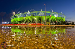 London 2012 Olympic Stadium (david gutierrez [ www.davidgutierrez.co.uk ]) Tags: park city uk travel blue roof light sky urban reflection building green london art sports water beautiful sport skyline architecture modern night clouds reflections photography design photo interesting athletics construction europe cityscape exterior angle image pentax bokeh dusk stadium top steel perspective arts creative engineering wrap running landmark games icon tourist structure fisheye stunning bluehour unusual colourful olympics venue olympicstadium stratford sustainable 2012 eastlondon olympicgames london2012 buildingreflection centrepiece londonuk paralympic populous 1017mm hoksport davidgutierrez pentaxk5