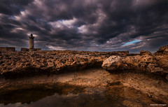 there is an air of storm (Massilo) Tags: longexposure shadow sky lighthouse nature wet water rock stone clouds nikon rocks nuvole syracuse sicily catania sicilia siracusa landascape nikond90 capomurrodiporco