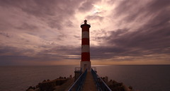 pharerouge (Amanclos) Tags: lighthouse seascape france clouds landscape nuages paysage aude phare matin languedocroussillon matinée pharerouge pharedeportlanouvelle
