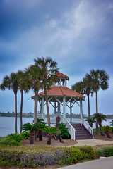 seashore gazebo and palm trees in florida (DigiDreamGrafix.com) Tags: ocean park travel blue sea summer vacation sky white tree green tourism nature water beautiful garden season islands coast wooden alley paradise afternoon florida outdoor path empty lifestyle sunny nobody tent palm resort exotic walkway shore tropical romantic pavilion rest leisure relaxation seashore coconuts inviting overview secluded paved welcomed