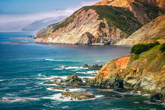 Central California Coast (byron bauer) Tags: sea sky painterly color water clouds rocks sunny cliffs pacificocean shore textured byronbauer