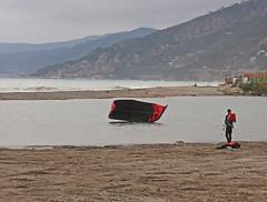 kitesurfer in a grey day (ludi_ste) Tags: mouth river kitesurf kitesurfer blackandred foce albenga fiumecenta