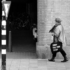 Shop till you drop (Akbar Simonse) Tags: street people urban bw woman holland netherlands monochrome square zwartwit candid streetphotography denhaag thehague shoppingbag streetshot straat straatfotografie shoptillyoudrop straatfoto straatfotograaf dedoka akbarsimonse