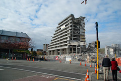 Still Looking! (Jocey K) Tags: road street autumn trees newzealand christchurch people colour building cars fence buildings demolition van footpath deconstruction archtitecture crowneplaza roadcones earthquakedamage