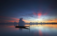 Tranquility (Azer Naudzer a.k.a PokYa) Tags: morning light reflection beach clouds sunrise boat colours getty kelantan pantai7