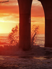 A Splash of Orange (Steve Taylor (Photography) Internet V slow) Tags: ocean sea newzealand christchurch sky orange clouds sunrise dawn pier support brighton waves pacific horizon canterbury nz southisland column splash peir sunup daybreak crashing newbrighton