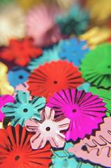 Pinwheels and Flowers - Soft Version (JebbiePix) Tags: blur flower macro closeup rainbow colorful pentax metallic multicolored sequins zykkor