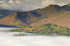 Lake of Mist (John Ormerod) Tags: uk morning autumn trees light shadow england mist lake mountains fog landscape nikon october day lakedistrict hills cumbria fells derwentwater keswick d7000