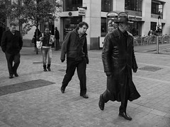 P1000579-1 (Lawrence Holmes.) Tags: uk blackandwhite hat lumix mono leeds parkrow streetphotography clocked 14mm gf1 candidandstreet