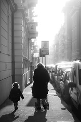Strolling with grandma and light (Giulio Magnifico) Tags: city grandma light urban woman sunlight inspiration lady composition relax happy shadows child emotion walk candid citylife streetphotography happiness udine fairytails nikond800e nikkormicro105mmafsvrf28