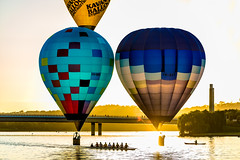 Bathing In The Light (David Tao Photography) Tags: bridge water sport sunrise balloons balloon