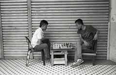 checkmate (denise yeap) Tags: people blackandwhite monochrome analog friendship stranger malaysia pointandshoot kualalumpur analogue 135 dailylife blacknwhite gamers chowkit checkmate compactcamera