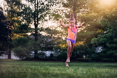 (Rebecca812) Tags: trees portrait sports girl grass canon outdoors jump child action candid running run gymnastics lensflare midair anticipation athlete determination lowangle healthylifestyle rebecca812