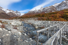 The Nature Trail to Laguna de Los Tres. (baddoguy) Tags: blue autumn winter mountain lake snow reflection southamerica argentina horizontal iceage forest outdoors photography canal twilight footbridge nopeople glacier adventure clearsky eroded rockformation mountainrange chalten cloudsky traveldestinations colorimage mtfitzroy famousplace nonurbanscene santacruzprovinceargentina woodmaterial rockobject