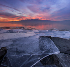 Broken (Up and Down) (Adam's Attempt (at a good photo)) Tags: pink blue winter sunset red orange mountain lake cold ice broken water utah nikon rocks colorful purple calm utahlake d90 americanforkboatharbor