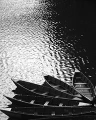 Lonely Boats ( Jamie Mitchell) Tags: nepal people woman lake man vegetables hat rain boats boat women tourists elderly monsoon vendor nepalese pokhara seller fewa tranquil tal topi