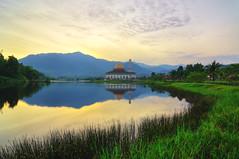 Just Another Sunrise (mozakim) Tags: morning sky mountain lake reflection green grass sunrise peaceful mosque calm serenity hdr zaki 5exps darulquran mozakim