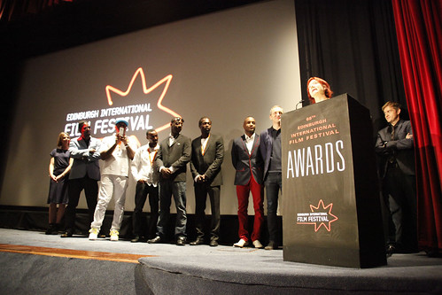 Penny Woolcock and the One Mile Away cast onstage after winning the Michael Powell Award at the 2012 EIFF Awards ceremony