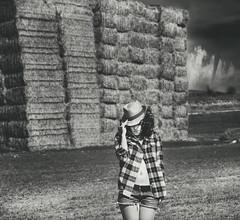 Bad girl (Nanihta (Sol Vázquez)) Tags: portrait españa white storm black art sol girl hat weather female clouds photoshop photography belt spain chica natural cloudy femme bad stormy curly disaster western tormenta shorts plaid tornado fatale mala classy fotografía vazquez cutoffs ombligo vázquez huracán huracane nanah nanihta