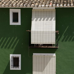 shades of green (jenny downing) Tags: windows light shadow white green frames spain bars iron mediterranean shadows bright framed balcony wroughtiron shades espana tiles shade blinds barred vivaespana shaded scalloped villajoyosa lavilajoiosa notpaper inspain unrolled jennypics jennydowning espanamixta photobyjennydowning housefrontdetail