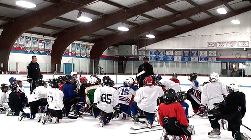 Brad Perry coaching a hockey school in Chicago  21