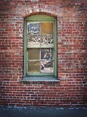 Whispering in My Ear (skipmoore) Tags: brick window oakland explore