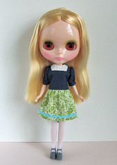 navy blue blouse and green skirt