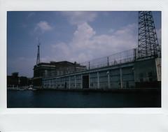 City Pier Broadway (ashleycampbell) Tags: film polaroid harbor pier md fuji maryland baltimore instant innerharbor fellspoint citypierbroadway fuji210wideformatinstantcam