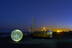 RX174 (Stoff74) Tags: uk light sea england moon lightpainting art beach ball painting person photography graffiti pier model photographie lumire flash feel perspective banksy orb p